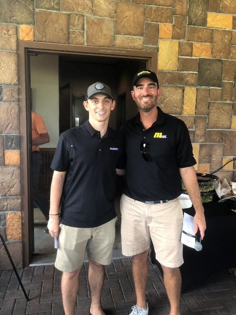 Kevin Anderson (left) won our Longest Drive competition on the 520-yard 17th hole.